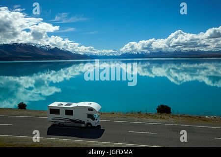 Campervan on State Highway 8, and Aoraki / Mount Cook reflected in Lake Pukaki, Mackenzie Country, Canterbury, South - Stock Photo