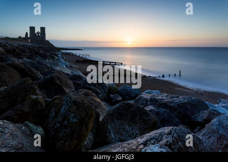 Sunset behind the Reculver Towers on the Kent coast near Herne Bay. - Stock Photo