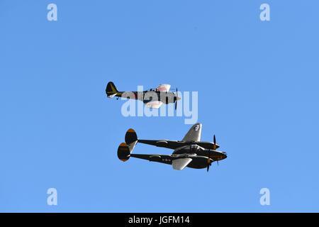 Lockheed P-38 Lightning flying with a Nakajima KI-43 'Oscar' - Stock Photo