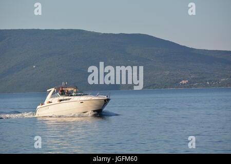 Cres, Croatia - June 18, 2017 - Motorboat near Valun on island Cres - Stock Photo