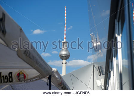 The Fernsehturm or Berlin TV tower reflected in a building. - Stock Photo