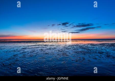 Sunset on tidal flats, Brewster, Cape Cod, Massachusetts, USA. - Stock Photo