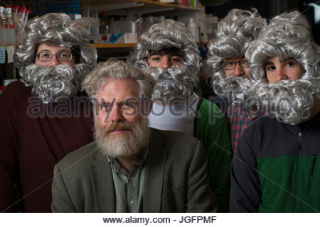 Initiator of The Human Genome Project, Dr. George Church, with post-graduate students who work in his lab, jokingly - Stock Photo