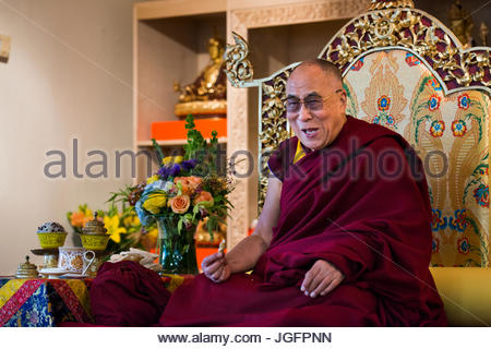 The Dalai Lama gives out a laugh during a visit to the United States. - Stock Photo