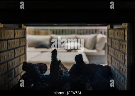 View from two sided fireplace with couch outside on loft balcony - Stock Photo