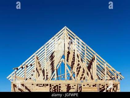 New construction house frame. - Stock Photo
