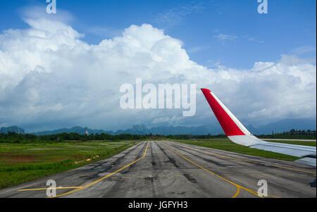 Looking through window aircraft during flight at runway. - Stock Photo