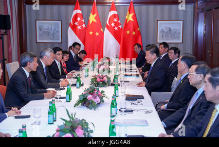 Hamburg, Germany. 6th July, 2017. Chinese President Xi Jinping meets with Singaporean Prime Minister Lee Hsien Loong - Stock Photo