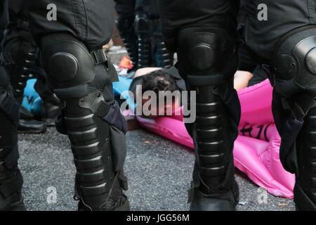 Hamburg, Germany. 6th July, 2017. A protester is arrested as violence breaks out at an anti g20 protest Credit: - Stock Photo
