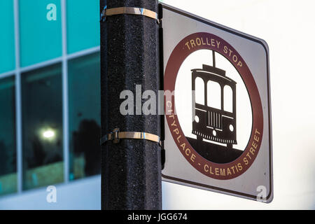 West Palm Beach, Florida, USA. 6th July, 2017. Trolley stop sign for City Place and Clematis Street in West Palm - Stock Photo