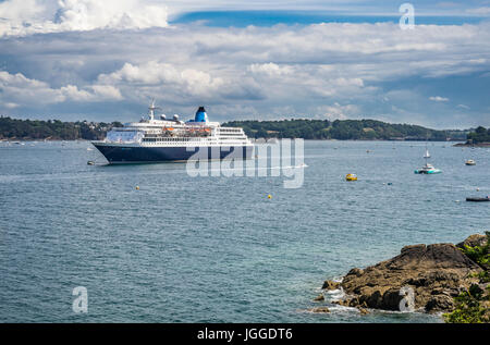 France, Brittany, Dinard waterfront, view of cruise ship Saga Sapphire, moored on the River Rance - Stock Photo