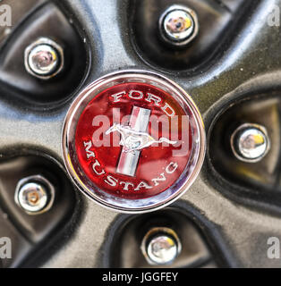 Classic Ford Mustang logo on hubcap with lugnuts - Stock Photo