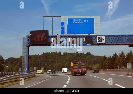 Travelling along the M4 motorway towards Cardiff in an eastward direction showing light traffic ahead and signage - Stock Photo