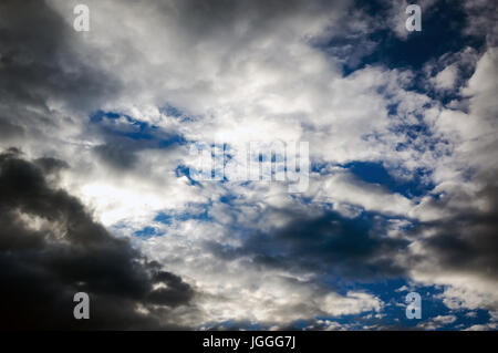 Storm clouds with the rain. Ominous sky. The soft cloud is on the blue sky - Stock Photo