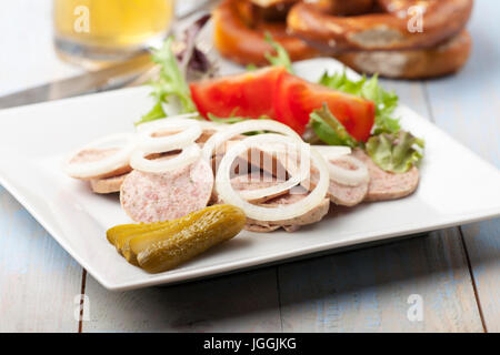 bavarian sausage salad with a pretzel - Stock Photo
