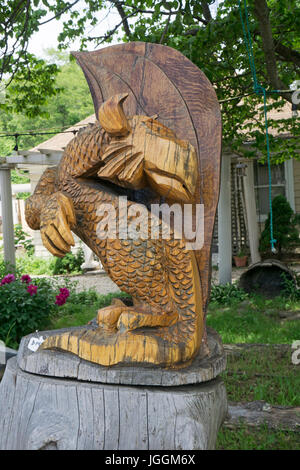Mysterious chainsaw wood carving by Artist Fred Steffen for sale roadside near the LIE in Manorville, New York. - Stock Photo