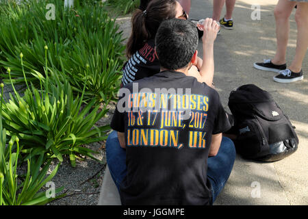 Man wearing Guns N' Roses 16 & 17 June, 2017 London, UK'  tshirt  at music concert at Queen Elizabeth Olympic Park - Stock Photo