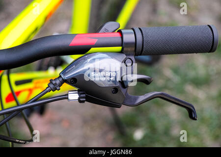 Tambov, Russian Federation - May 07, 2017 Shimano brake lever on handlebars. Close-up. - Stock Photo