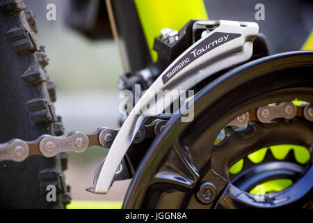 Tambov, Russian Federation - May 07, 2017 Close-up of Shimano Tourney front derailleur on bicycle chainwheel. - Stock Photo