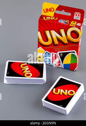 Tambov, Russian Federation - August 15, 2013 Two decks of UNO game cards and UNO game box on gray background. Studio - Stock Photo