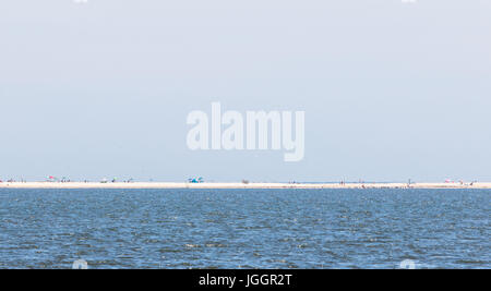 a distant view from across Mecox bay to scott cameron beach in watermill, ny - Stock Photo