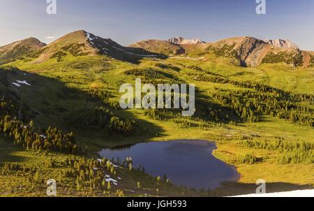 Scenic view of Healy Pass Meadows Alpine Environment below Monarch Mountain on Great Hiking Trail in Banff National - Stock Photo
