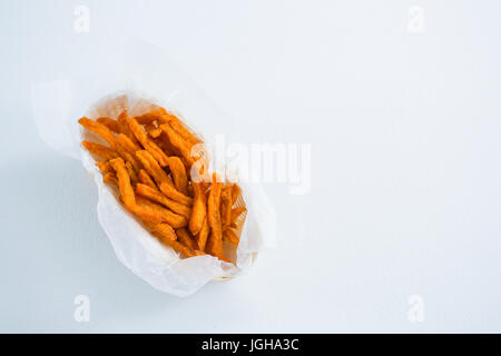 Close up of French fries in container on white background - Stock Photo