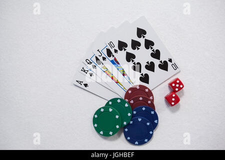 Playing cards, dice and casino chips arranged on white background - Stock Photo