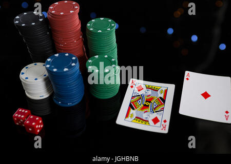 High angle view of cards and chips with dices on table - Stock Photo