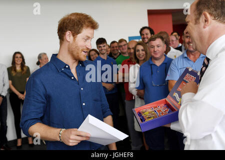 Prince Harry is presented with a specially-made box of sweets called 'Harry Mix' at the Haribo sweet factory on - Stock Photo