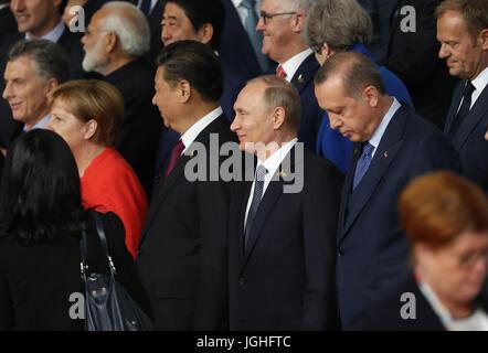 Turkish President Recep Tayyip Erdogan (right) and Russian President Vladimir Putin (centre) arrive for a family - Stock Photo