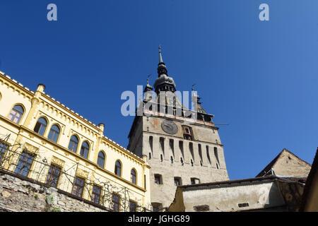 Unesco World Heritage Clock tower in Sighisoara Transylvania Romania - Stock Photo