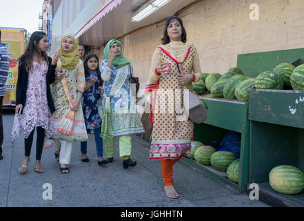 South Asian women walking on 73rd Street in Jackson Heights, Queens, New York City. - Stock Photo