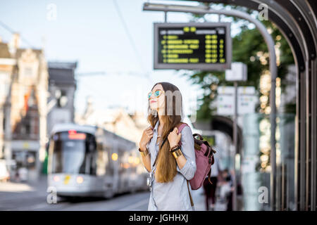 Woman on the tram station - Stock Photo