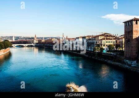 Adige River viewed from Castelvecchio Bridge (Ponte di Castelvecchio). Verona, Province of Verona, Italy. 10.12.2012 - Stock Photo