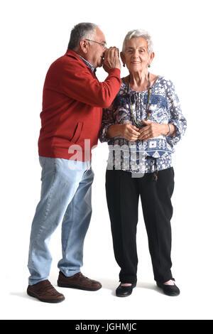 secrets senior couple on white - Stock Photo
