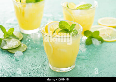 Refreshing citrus cocktail with lemon - Stock Photo