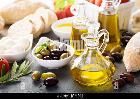 Mediterranean cuisine with olive oil, cheese and bread - Stock Photo