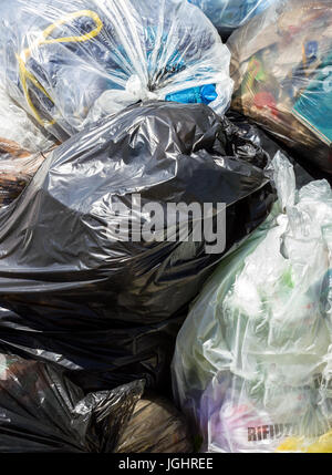 Piles of garbage in plastic bin bags. Landfill. Close-up for background. - Stock Photo