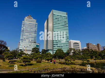 Tokyo, Japan - Jan 4, 2016. Modern buildings with a park at business district in Tokyo, Japan. Tokyo is Japan capital - Stock Photo