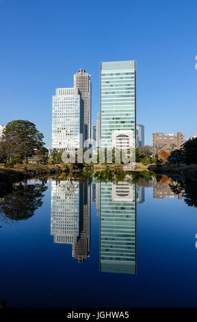 Tokyo, Japan - Jan 4, 2016. Modern buildings with a reflection lake at business district in Tokyo, Japan. Tokyo - Stock Photo