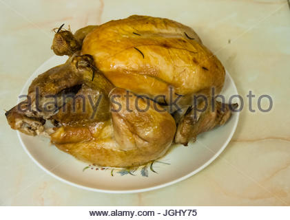Chicken roasted with rosemary fresh out of the oven. Home cooked. - Stock Photo