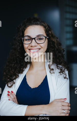 Smart, smiling business woman - Stock Photo