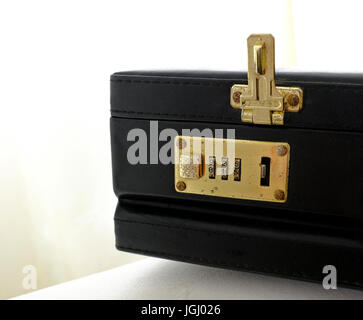 Combination lock on an old briefcase - Stock Photo
