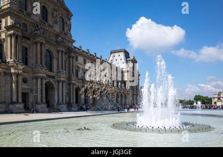 Paris, France - May 14, 2014: The Denon pavilion is one of the three entrances of the Louvre Museum. - Stock Photo