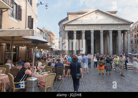 Early evening tourists enjoy cafe and sights in front of ancient Pantheon, Rome, Italy. Sun setting, scenic, no - Stock Photo