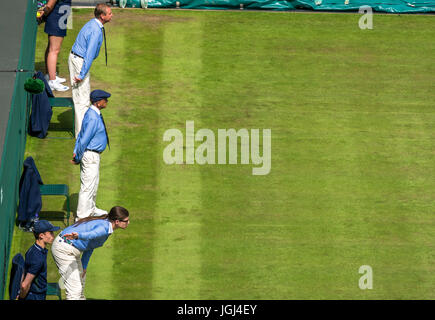 Line judge on Centre Court holds out arm to indicate ball is out Wimbledon tennis championship 2017, London, England, - Stock Photo