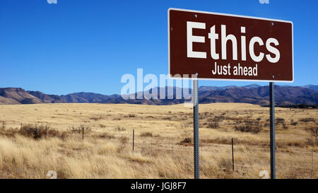 Ethics road sign with blue sky and wilderness - Stock Photo