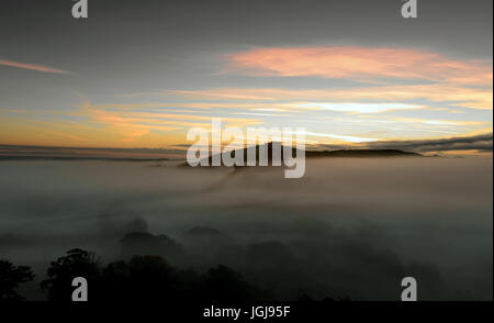 Corfe castle in the morning mist - Stock Photo