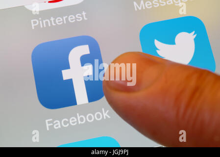 Facebook and Twitter apps on cellphone - Stock Photo